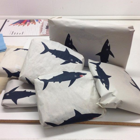 Love this simple shark wrapping paper by Lorienstern. pic posted by www.halcyonnights.com.au