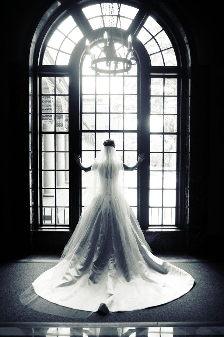 Every bride needs a window photo in her dress! Photo by Kim. #WeddingPhotographerMinnesota #WeddingDress