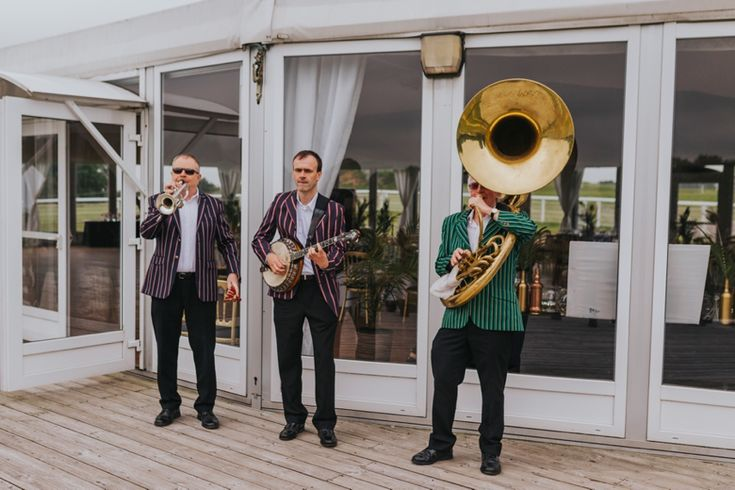The perfect accompaniment for a 1920s wedding. Photo by Benjamin Stuart Photography #weddingphotography #weddingmusic #1920stheme #sousaphone #banjo #weddingentertainment