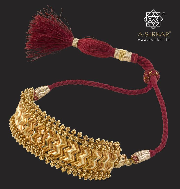 Riddhima Bajuband:  Adapted from our ever-popular Addigai necklace, this grand armlet also doubles up as a choker. Handcrafted in pure 22K gold, completed in a barely discernible antique finish, with a contrasting red rope tassel for greater effect.