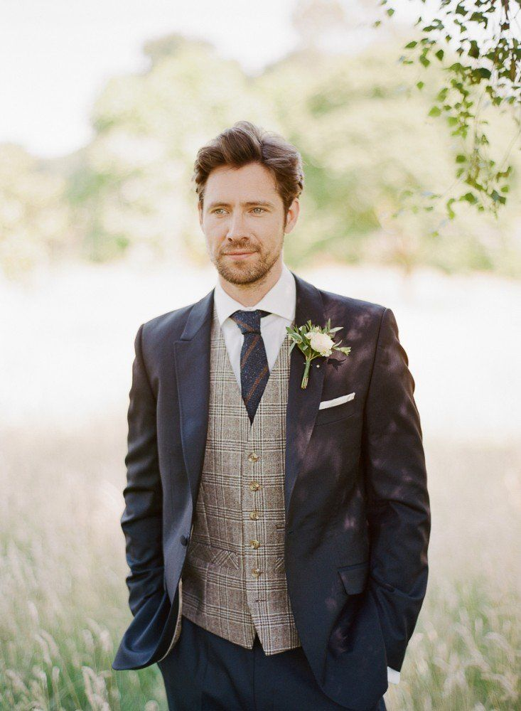 Our handsome english country gentleman from our quintessentially romantic garden of england wedding inspiration shoot, suit from Stephen Bishop Suiting, florals by Jennifer Pinder
