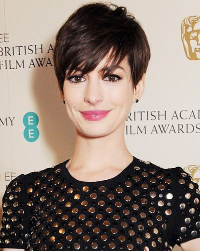 """Salon Inspiration: The Best Celebrity Bangs — Anne Hathaway (InStyle) (""""The longer pieces of [her] pixie minimize the dreaded growing-out period."""") (photo by Dave M. Benett/Getty Images)"""