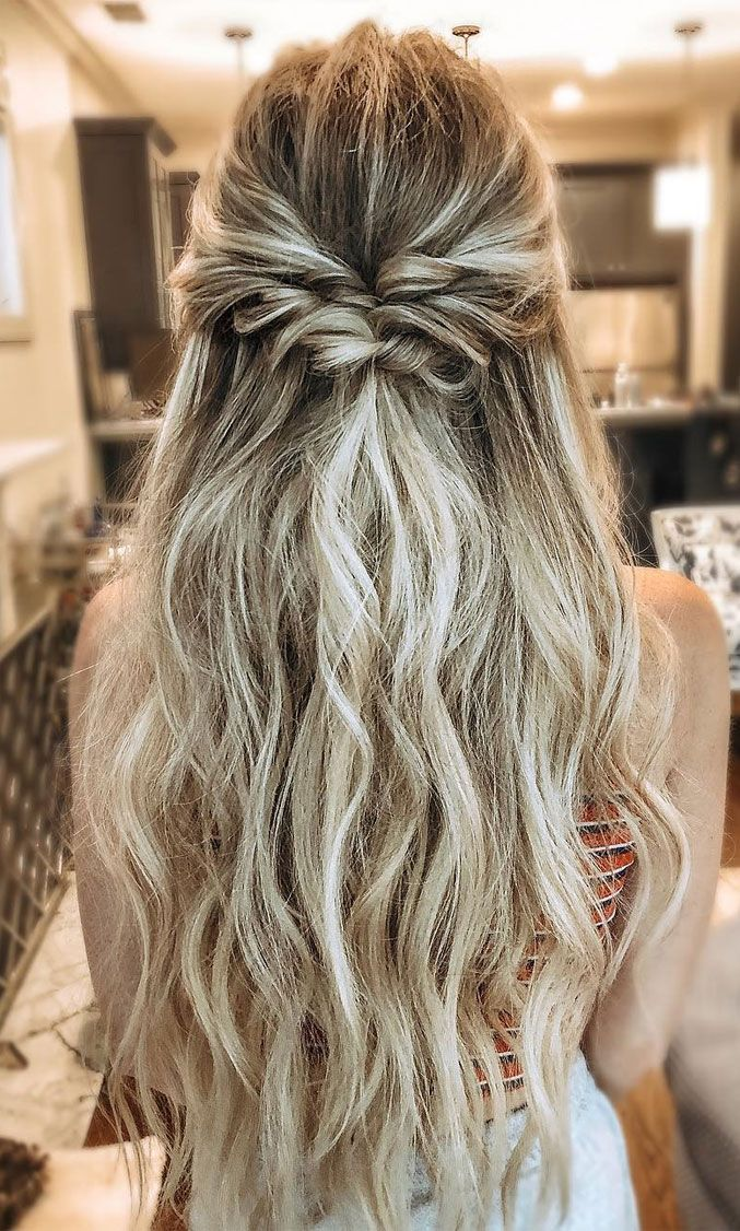 From flowy boho and simple braid partial updo, professional perfection and do-it-yourself options. All of these looks allow you the the best of both worlds – the natural femininity of your long hair flowing loose while keeping it out of your face and creating an anchor for a veil.
