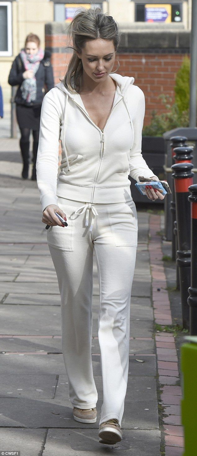 Georgina Dorsett flaunts cleavage in low-cut  all-white tracksuit #dailymail