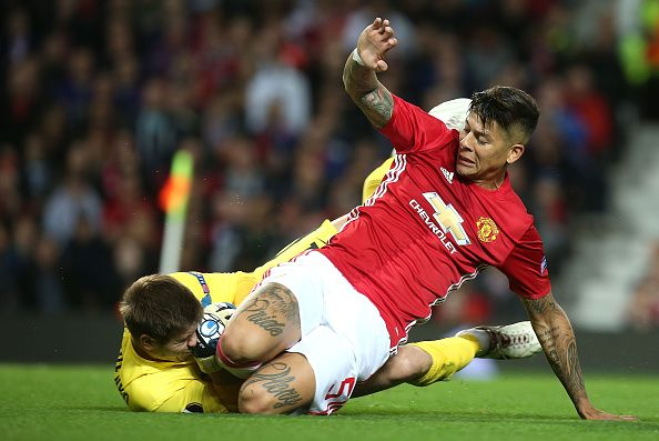 Marcos Rojo of Manchester United is beaten to the ball by Oleksiy Shevchenko of Zorya during the UEFA Europa League match between Manchester United...