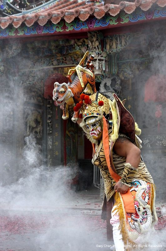 """""""Guanjiang Shou"""" (官将首) by Chan Kwok Hung, taken in Taiwan!!! GuanjiangShou troupes are one of Taiwan's most popular activities and may be seen all over Taiwan at traditional folk-religion gatherings. With their fiercely painted faces, protruding fangs, and powerful, choreographed performances, they are easily recognized. They may be described as underworld police or gods' bodyguards. https://www.facebook.com/sinocollection/"""