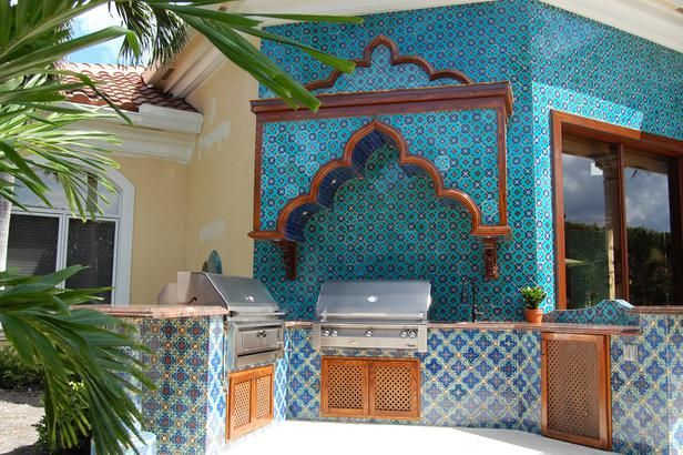 Moroccan-inspired moldings and bright patterned tile lend an old world feel to this outdoor kitchen.