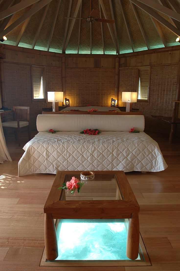 The glassbottom table in an overwater bungalow in the Tikehau Pearl Beach Resort