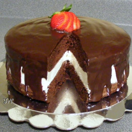 Ding Dong Cake - Reminiscent of the famous snack cake we all loved as kids! A thick layer of homemade cream filling sandwiched between chocolate cake layers then topped with ganache.