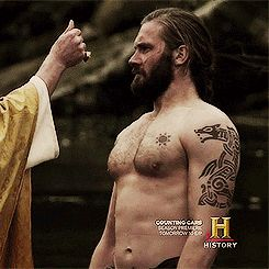 ROLLO - A LITTLE FREAKED OUT.  THIS SCENE IS HISTORICALLY CORRECT.  HE WAS BAPTIZED BY THE ENGLISH.  THE REAL ROLLO LOTHBROK IS MY ANCESTOR.