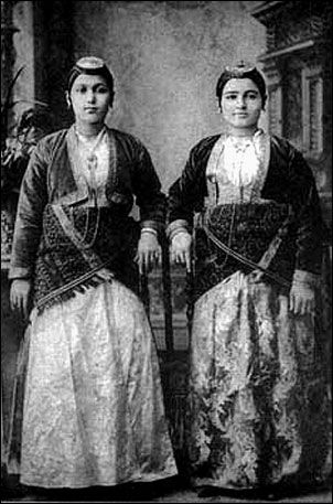 Traditional festive costumes of the 'Rum' (Greek-Orthodox) inhabitants from the Pontos region (Black Sea coast and hinterland). Late-Ottoman era, urban style, early 20th century. They were expelled from Turkey in 1923, in exchange for Muslim populations from Greece. At this occasion Turkey lost a lot of cultural and economic potential, and the expelled lost their homeland.