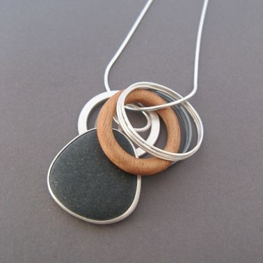 Pebble pendant with wooden hoop   Contemporary Necklaces / Pendants by contemporary jewellery designer Grace Girvan