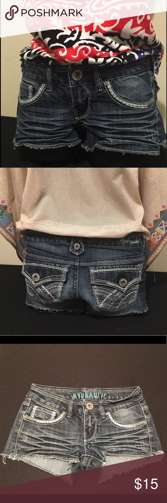 Hydraulic Jean denim shorts Hydraulic Jeans denim short-shorts, cheeky low rise, factory distressed, embroidery detailing on pockets. See photos for measurements. In excellent condition. Smoke-free home. Hydraulic Shorts Jean Shorts
