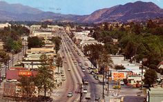 """Postcard picturing Ventura Boulevard, Studio City, California. Verso reads, """"This boulevard joins the San Fernando Valley with the blue Pacific. San Fernando Valley History Digital Library"""