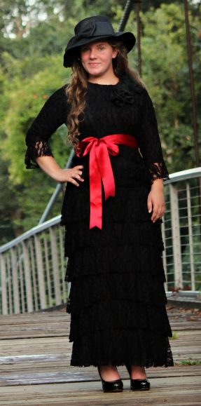 """Elegant """"Couture Lace Collection"""" in black with a red sash to accent it. These beautiful pieces can be ordered online at www.zadiebs.com"""