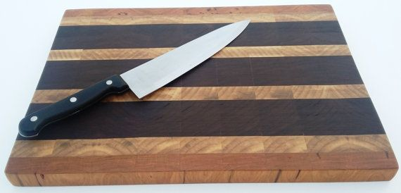 Fantastic End Grain Cutting Board made from Walnut,Maple, and Cherry perfect for your chopping needs and protecting your knives from damage. This Board was handmade by a craftsman in the USA. Dimensions: 15x10.75x1 Materials: Walnut,Maple, Cherry Use: For cutting vegetables, fruit and cheese. Not suitable for cutting meat due to bacteria NOT DISHWASHER SAFE All Arkeo Woodcraft products are handmade in a home studio by craftsman Glen Huff. Glen is a physical therapist assistant by day and…
