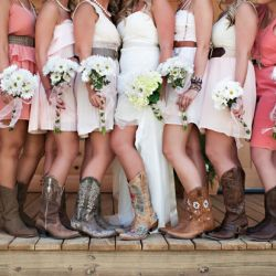 These bridesmaids rocked the cowgirl boots and short pink dresses!