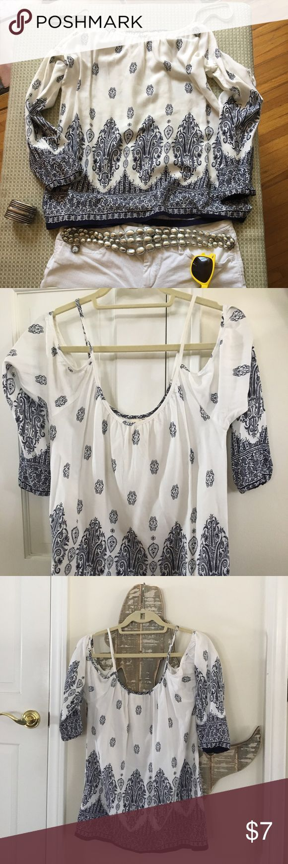 Paisley Blue and White Cold Shoulder Top Ideal with white jeans or maybe even a cute pair of red shorts for Independence Day! This has never been worn and is from a pet free smoke free home. Hit me up with any questions and I'm more than happy to answer!! Tops Blouses