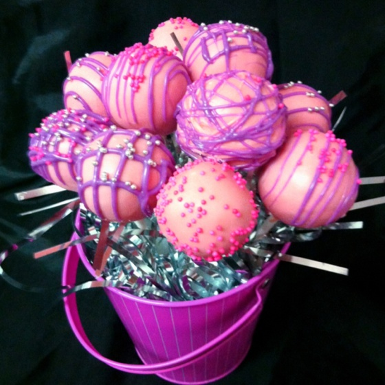 Pretty pink and purple birthday cake pops.  Might be a good activity for the girls to do and take home as party favors.  Anyone know what website it's from?