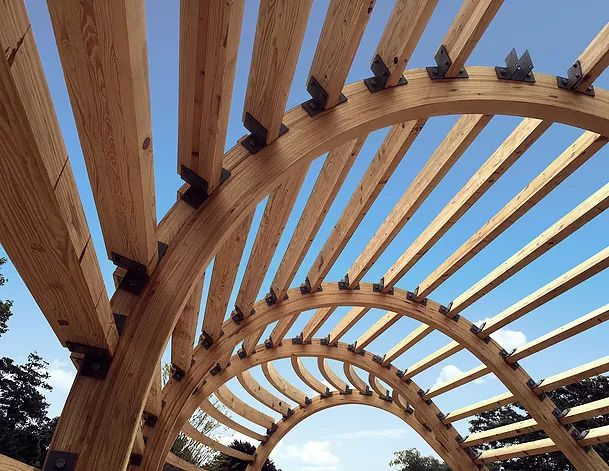 Curved glulam beams for an L shaped house. Glulam by Unalam!