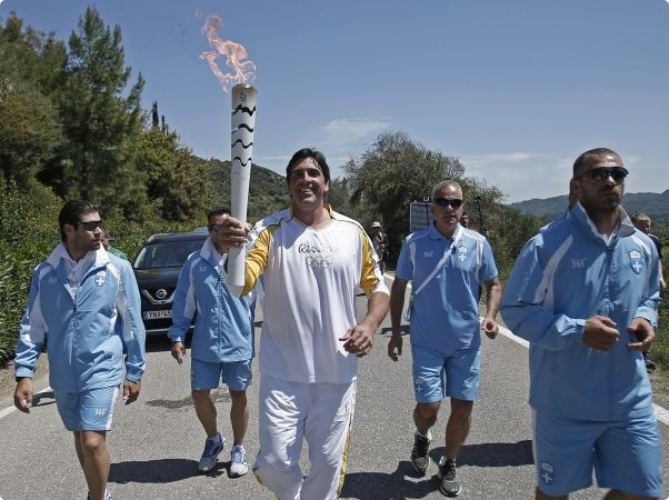 Giovane Gávio carries the Rio 2016 Olympic Torch shortly after the flame was lit in Olympia  (Photo: Rio 2016/André Luiz Mello) http://www.rio2016.com/en/news/i-want-to-inspire-all-brazilians-says-giovane-gavio-after-carrying-rio-2016-olympic-torch