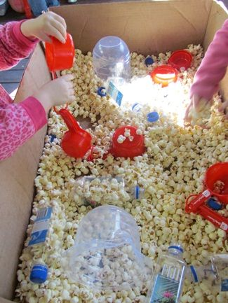 """""""The Popcorn Book"""" by Tomie dePaola and Exploring Popcorn and popcorn in the sensory bin"""