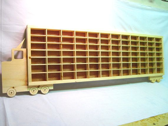 This is a Rustics Handmade 48 84 Car Wooden Truck Hot Wheels Matchbox Toy Boys Bedroom Wall Display Case Decor. Fishing lures, Pogs, or whatever else boys collect that are small nowadays can be displayed in the display case. This is the 48 model that is 54 long in total and holds 84 cars. What a great accent to a boys bedroom and keep his hot wheels die cast cars looking good. In the 4th pic notice how on the rear wheels there is a hitch hole for a tandem trailer hook up display case. The…