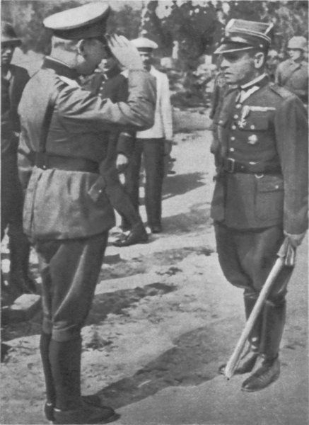 Major Suharski ( with sabre ) surrendering Westerplatte to General Eberhardt ( saluting ).