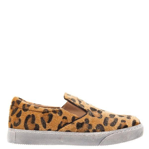 Animal print snakeskin slip on sneaker with white sole.