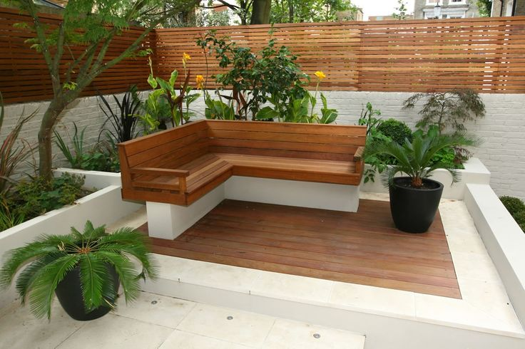 Small Garden 18 | Small Garden Design | Projects | Garden Design London. Like the raised stone platform with decking.