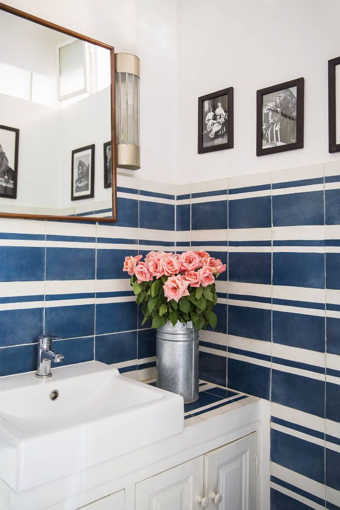 You can never go wrong with blue and white stripes. This bathroom comes alive with this lovely decorating idea.