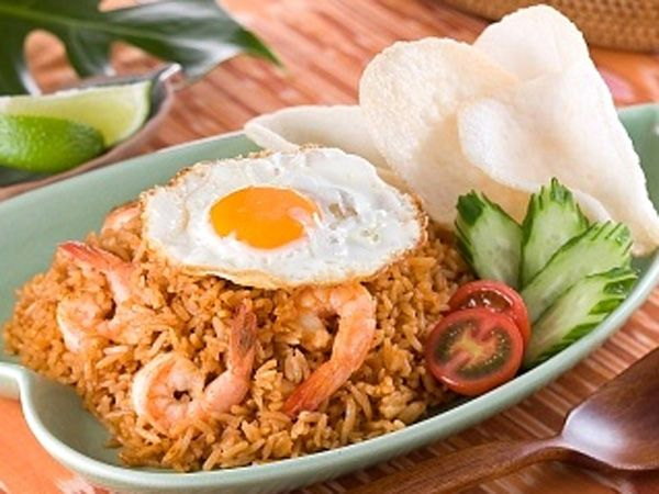 NASI GORENG (fried rice). Considered Indonesia's national dish, this take on Asian fried rice is often made with sweet, thick soy sauce called kecap (pronounced ketchup) and garnished with acar, pickled cucumber and carrots.  ♥