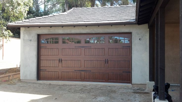 Garage Door Painted To Look Like Wood With Decorative