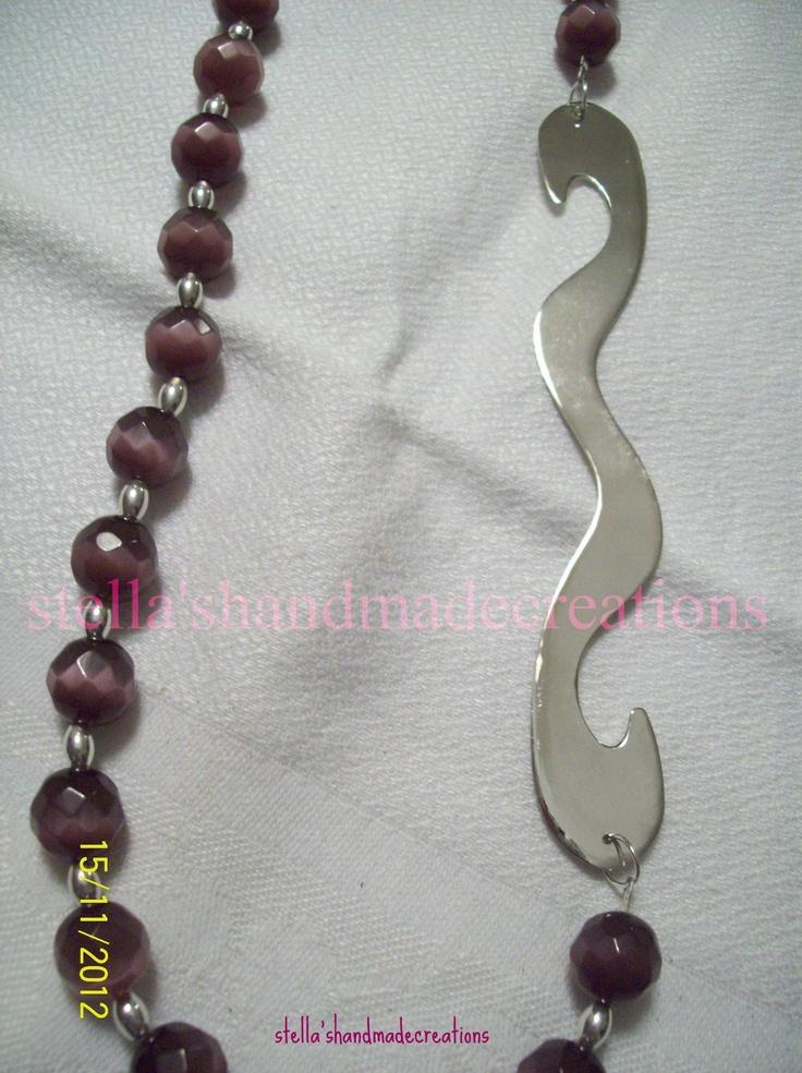 necklace with cat eye stones, silver and handmade alpaca pattern.  κολιέ με πέτρες μάτι της γάτας, ασημένια στοιχεία και χειροποίητο διακοσμητικό στοιχείο από αλπακά