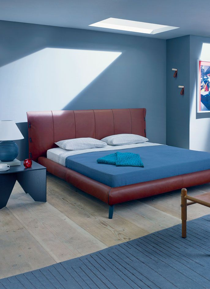 Cuf' bed, €3,450, by Mauro Lipparini, for Bonaldo. 'Acacia' sheets, $150; pillowcases, $115; 'Arc Matelassé' bedspread, $240, all by Calvin Klein Home. 'Labyrinth Calm Turquoise' throw, £210, by Cristian Zuzunaga. 'Calvert' table, £491, by Ferdinand Kramer, reissued by E15, from Viaduct. 'Solid' teacup, £17; saucer, £11.50, both by Dibbern, from The Conran Shop. 'Medium Sphere' lamp, $1,550 by Samuel Amoia, for Itz'ana Home. 'Fin' clock, price on request, by David Irwin