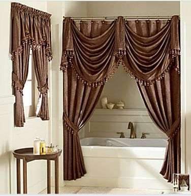 love all the curtains, especially around the tub.