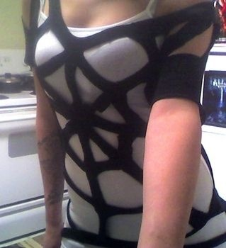 Cut out spider web t-shirt...for Halloween!(check out the name of the person who pinned before me...)