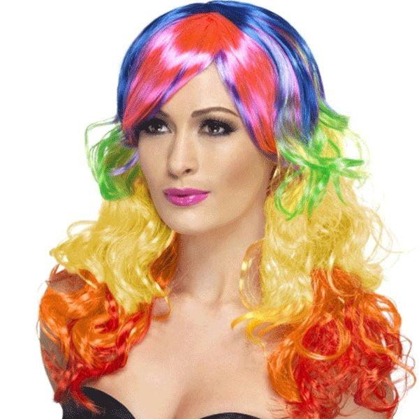 Regenboog pruik voor dames. Lange pruik voor dames, met krullend haar in verschillende kleuren.