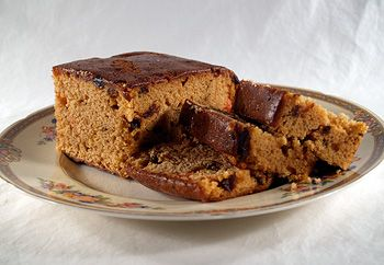 Genoa Cake is made with dark or light batter, with fruit in it, and then usually topped with nuts such as almonds, Brazil nuts or walnuts, and cherries, then glazed. http://www.cooksinfo.com/genoa-cake
