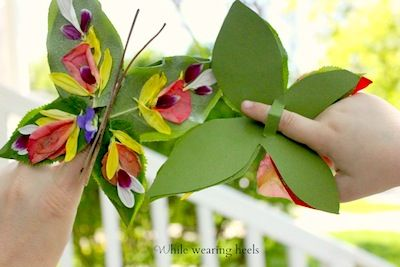 butterfly finger puppet from natural items like twigs flowers leaves