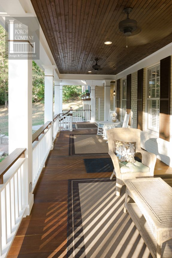 Tongue and groove front porch floor with two-tone porch rails create a striking and durable porch addition. | The Porch Company
