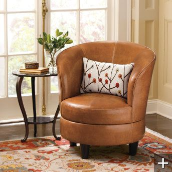 """Rebecca Leather Swivel Chair (grandinroad catalog)  I say """"yes"""" to this swivel barrel chair"""