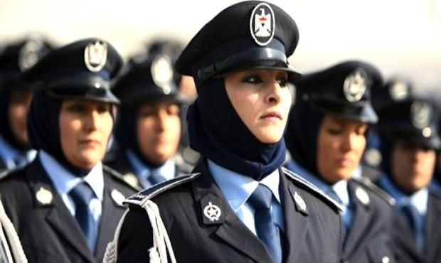 Iraqi police women march during a parade to mark 90 years since its foundation in the Iraqi capital Baghdad, on January 9, 2012.