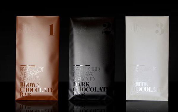 "Chocolate anyone? Elegant package and copy with a twist (""Say it out loud, I'm dark and proud."")"