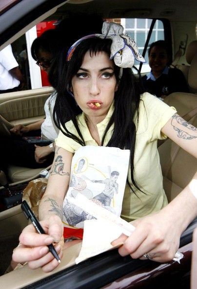 Amy Winehouse Photos Photos - FILE PICTURE dated Friday April 25 2008 of Amy Winehouse paying a visit to a local McDonalds. The 27-year-old Grammy Award-winning singer has been found dead in her London home. The cause of death is currently unknown. - BREAKING NEWS FILE: Amy Winehouse dies at the age of 27