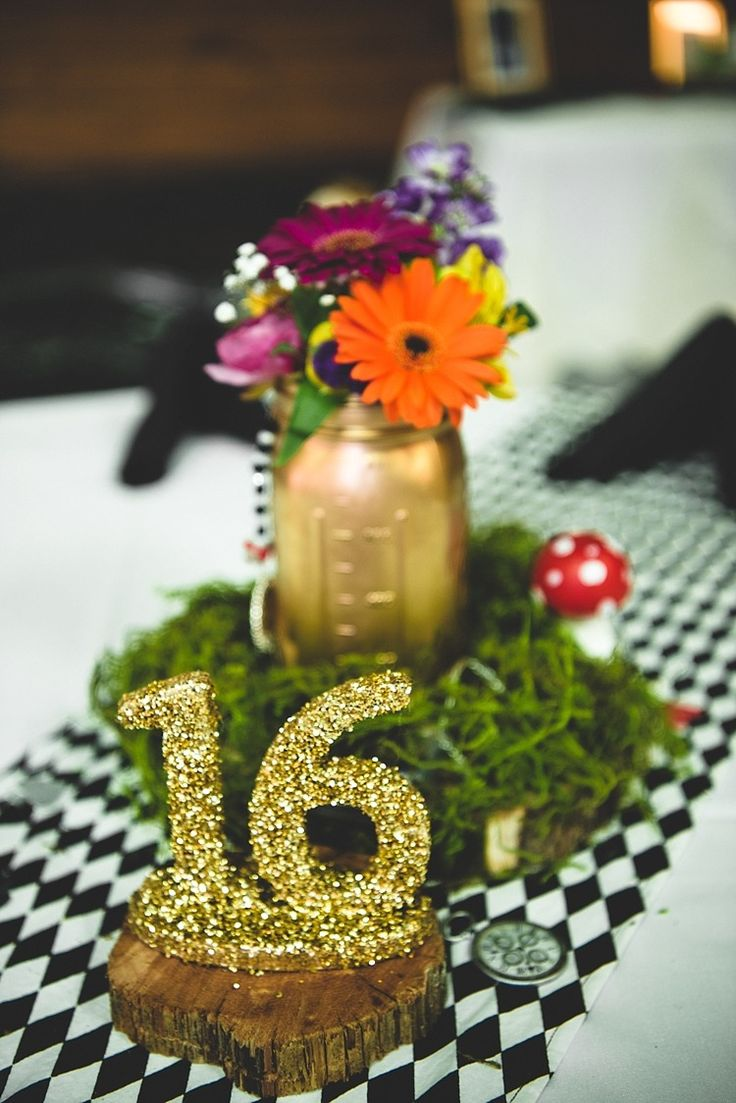 Reception Table Setting Glitter Table Number Gold Mason Jar Multicoloured Florals Gerbra Baby's Breath Greenery Mushroom Black And White Check Tablecloth Alice in Wonderland Wedding Pennsylvania http://www.julieflorophotography.com/