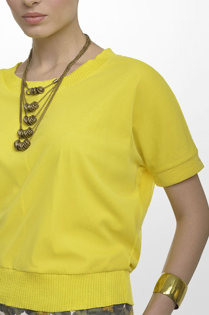 Sarah Lawrence - double layered short sleeve blouse, cropped printed pant, necklace.