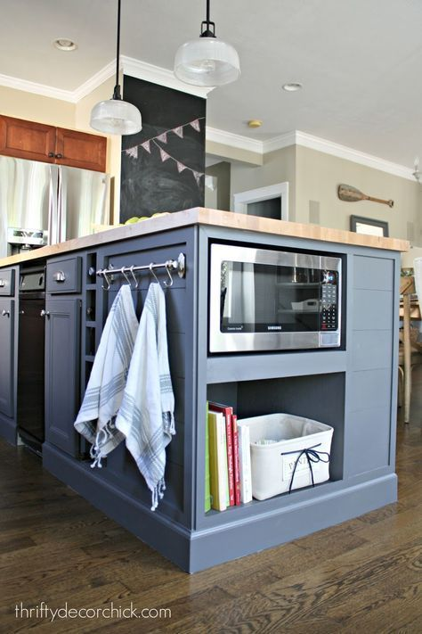 Painted bottom cabinets with under the counter microwave