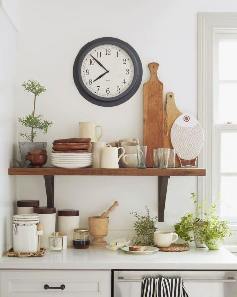 The owner of this rural Connecticut farmhouse switches around her kitchen accessories on a whim, so a neutral palette is essential. Almost every wall in the house, including those covered with barn-inspired board-and-batten paneling, is painted the same shade of white, and most of the furniture is covered in white or neutral linen.