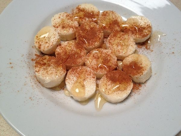 Craving dessert? Slice a banana, sprinkle cinnamon on it, and drizzle it with honey. This is so, so good and really tastes like dessert. and Healthy!
